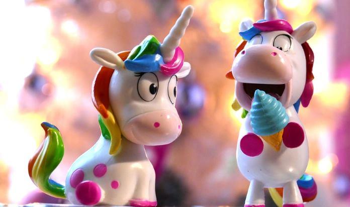Two Toy Unicorns Having fun.