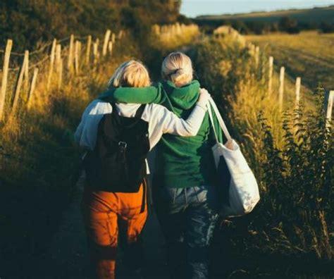 Best Friends walking in a field