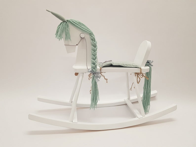 Wooden rocking unicorn in mint colors.