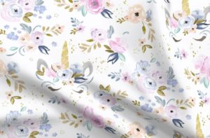 Fabric with flowers and unicorn faces