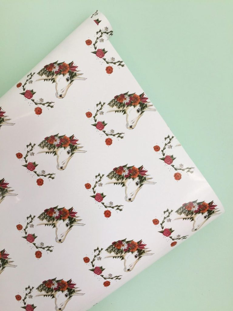 Unicorn gift wrapping paper with real unicorn and roses